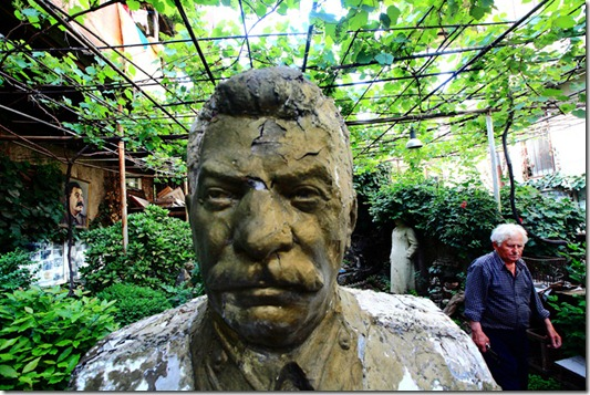 "Ushangi Davitashvili, 80, started making his own private museum of Stalin in the yard of his house  just after Great Leader's death in 53. Ushangi has about 10 stalin's statues, busts and portraits  of different sizes in his ""museum,"" as well artifacts of Soviet era, like rusty machine gun of World War II, Nazi soldier's helmet etc."