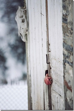 Margo Qaldani is opening the door lock from inside in Adishi.
