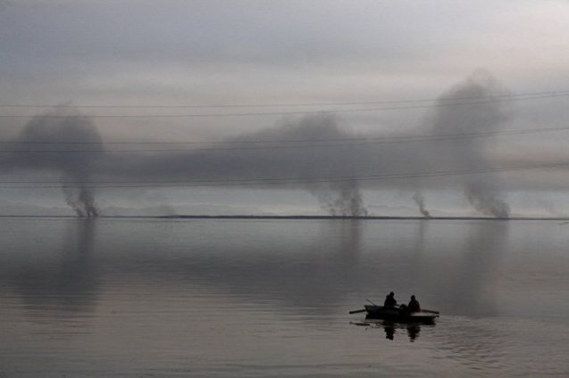 Hunters head for evening hunting, as smoke rises over the Paliastomi lake near Poti, Georgia on December 28. Paliastomi lake marshes are part of the Kolkheti National Park, and are often put on fire by hunters and cattle herders, who clear the area for easier fowling and cow grazing. Such a severe violation of the national park regulations – quite common in Georgia's protected areas – are greatly caused by poor management.